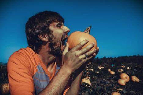 All About August - Man Eating a Pumpkin