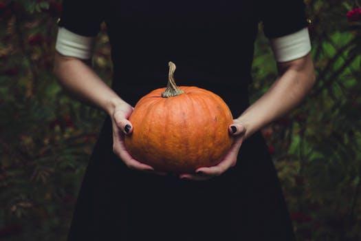 Clean T.O: 5 Tricks to Avoid Pumpkin Catastrophe Holding Pumpkin