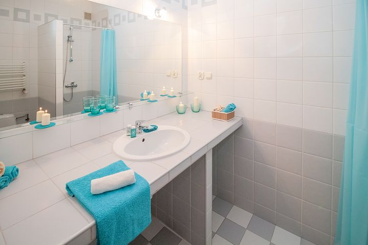 4 Habits to Keep Your Bathroom Spotless Blue Bathroom
